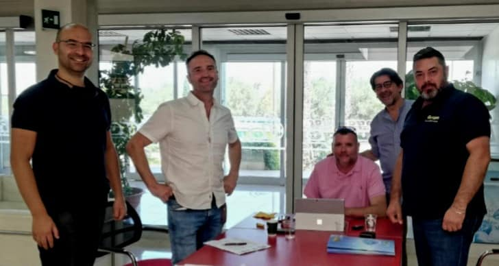 Patrick Curran (white shirt!) and Sean Gallagher (pink shirt!)  sign deal with Longo in their offices in Italy accompanied by Vito Longo, Longos CEO and Franco and Pasqual Longo