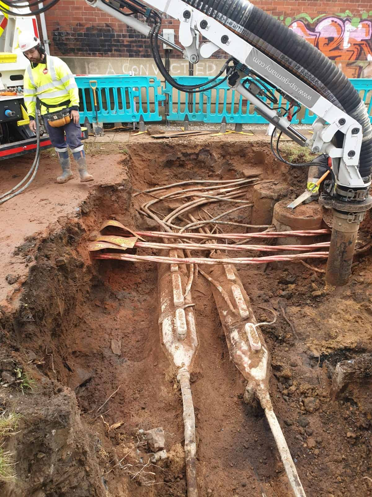 Vac UK digging around large power cables with vac ex